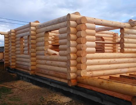 Услуги по строительству домов из оцилиндрованного бревна